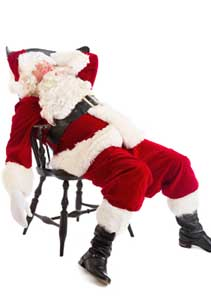 Tired Santa Claus Sitting On Chair